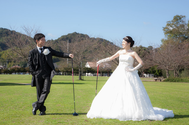 Couple playing golf  — Photo by A&K STUDIO