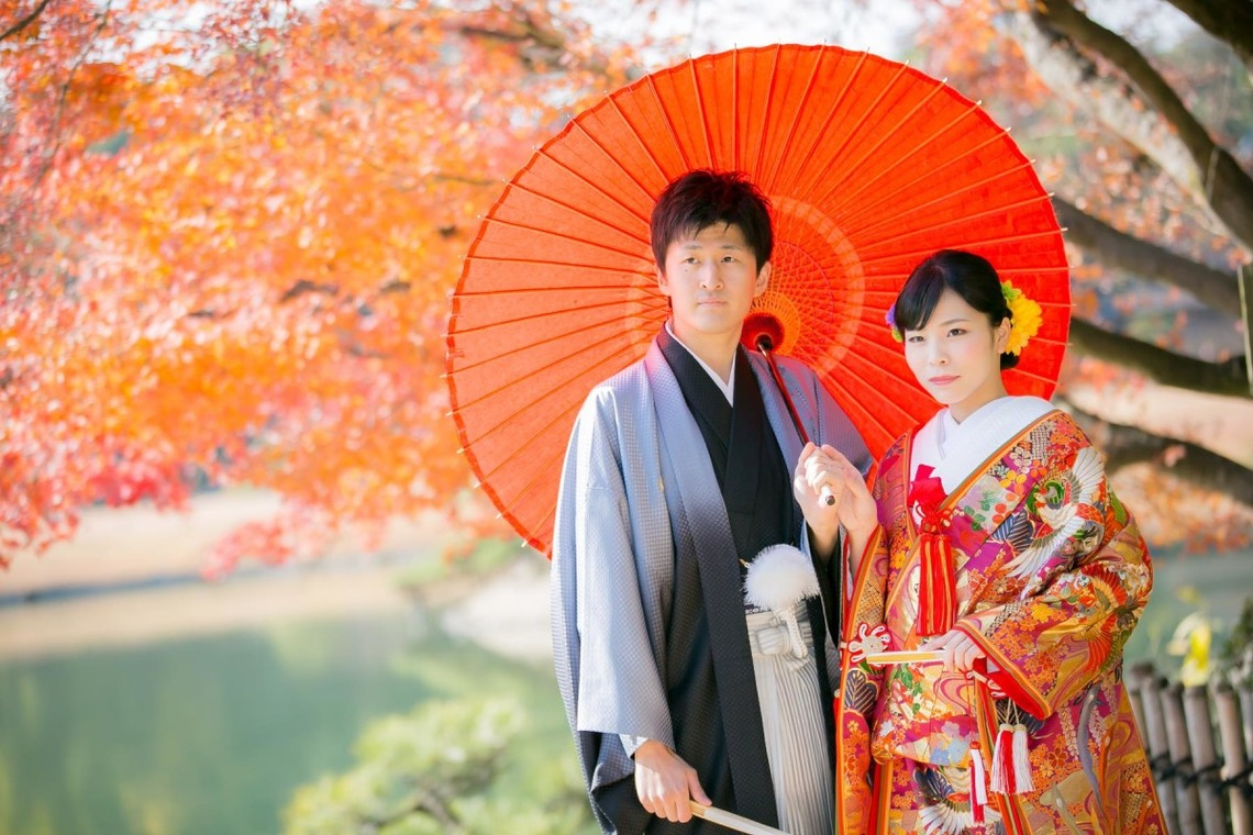 Couple in Kimono under the autumn leaves