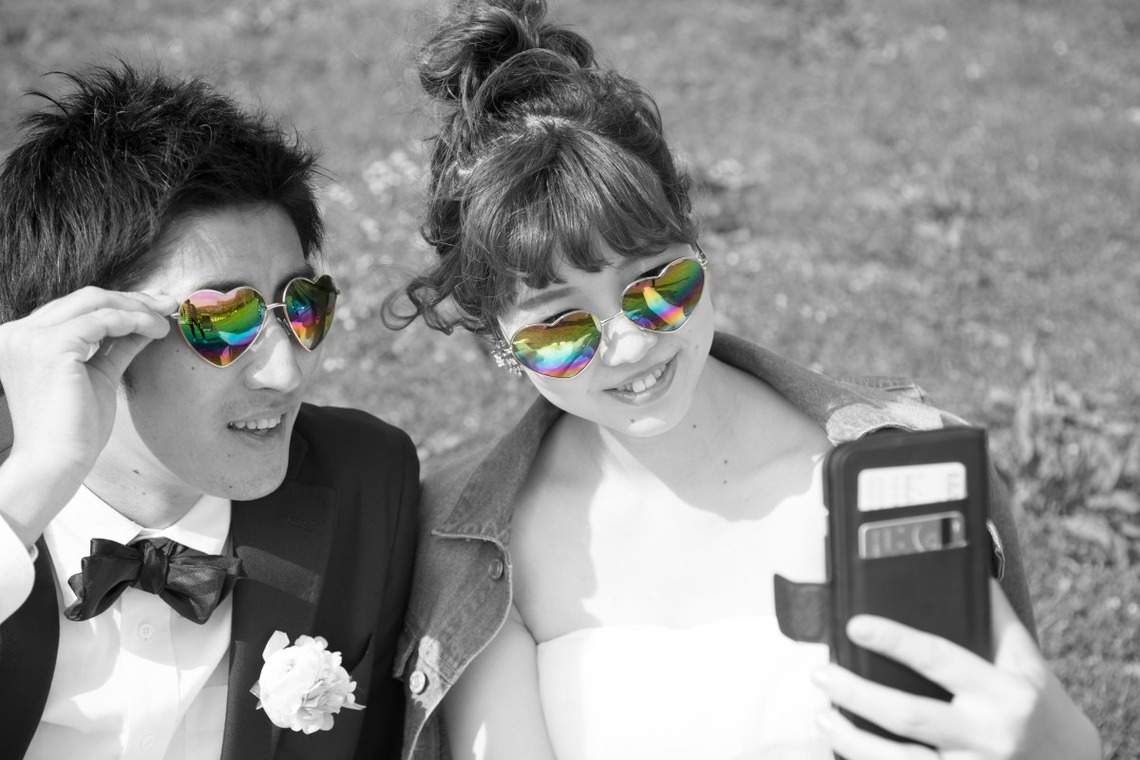 Bride and groom selfie  — Photo by Takano Kazuki