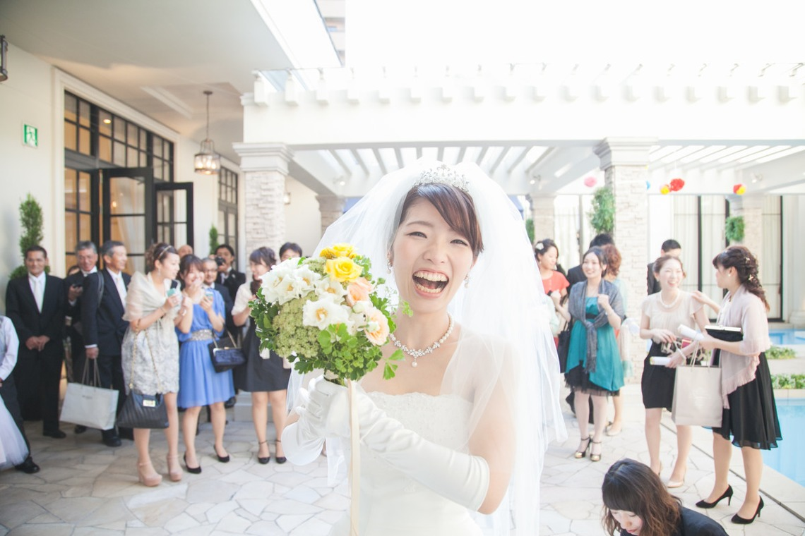 Bride posing with bouquet.