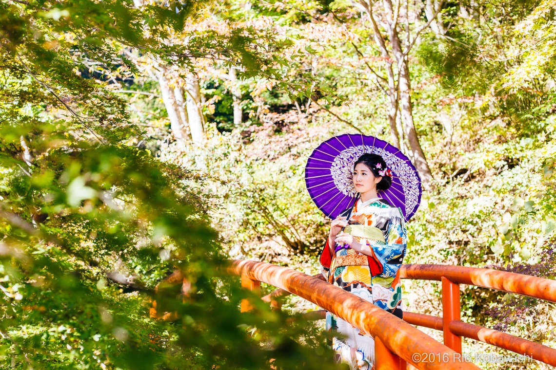 Lady wearing a hikifurisode standing on a bridge